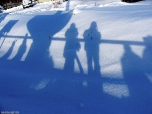 People's shadows in snowscape