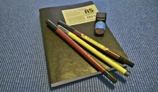 Seamus Phan, artist and his tools - disposable pre-inked Japanese brush pens and a sketchbook