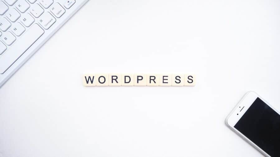 wordpress, keyboard, and smartphone