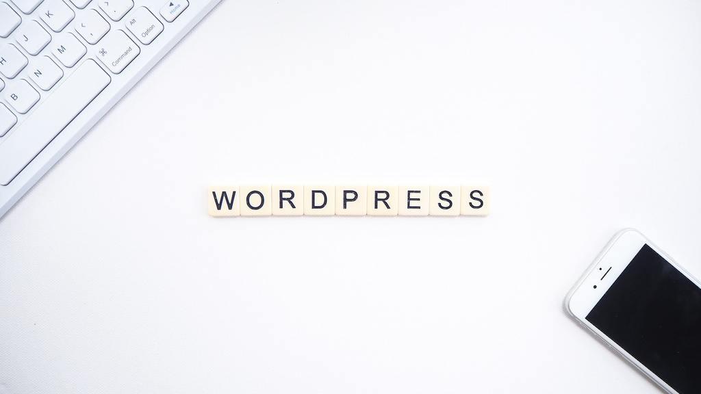 wordpress, keyboard, and smartphone